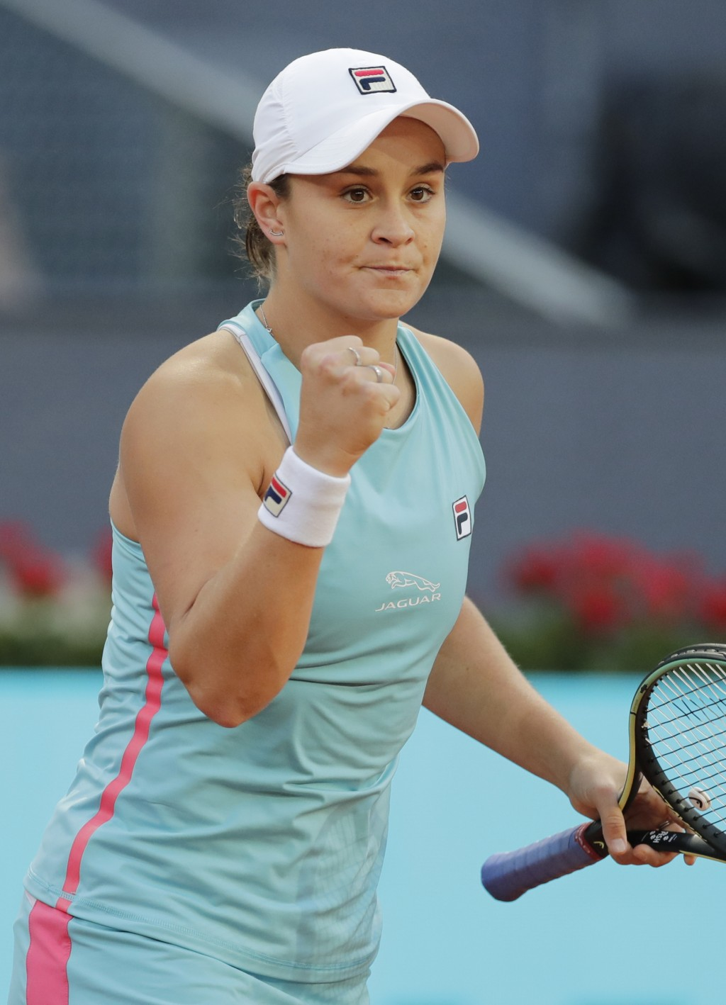 Ashleigh Barty of Australia celebrates after defeating Iga Swiatek of Poland during their match at the Madrid Open tennis tournament in Madrid, Spain,...