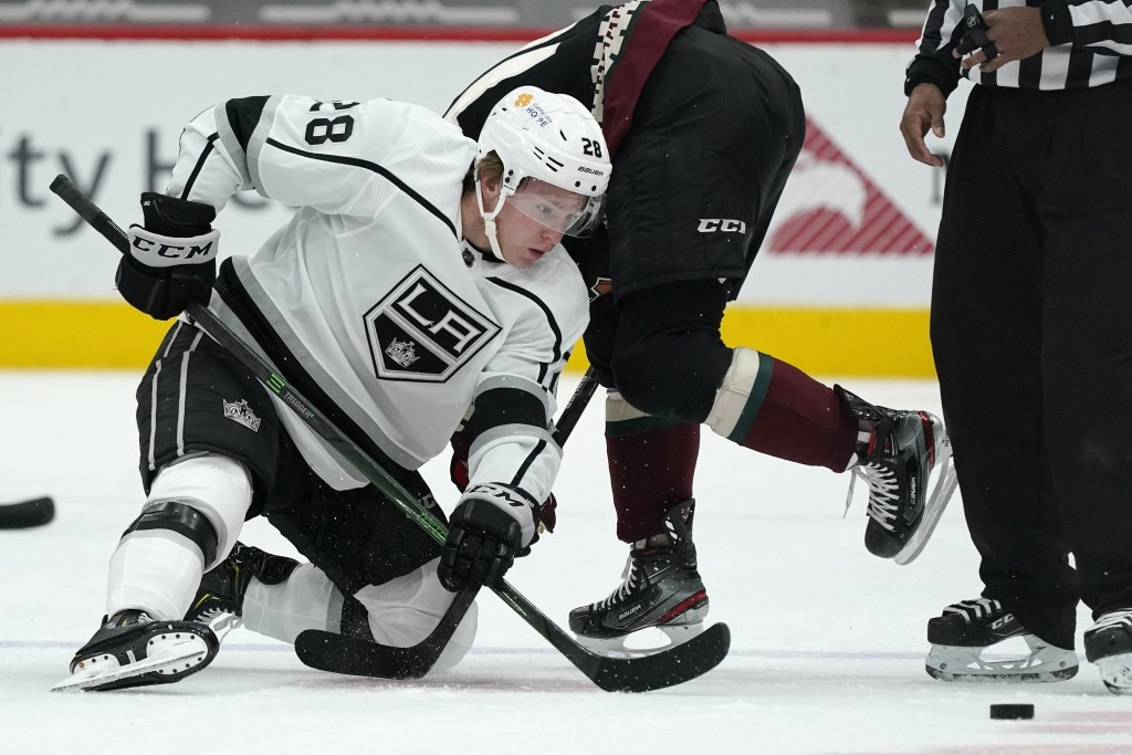 Los Angeles Kings center Jaret Anderson-Dolan (28) wins a face-off against Arizona Coyotes center Derick Brassard during the first period of an NHL ho...