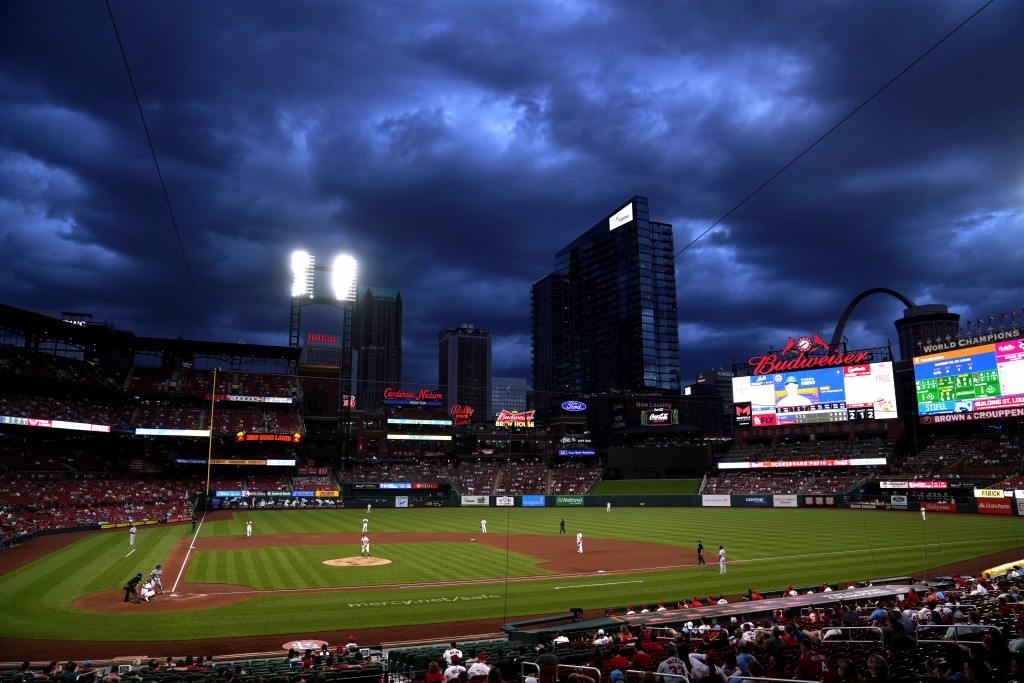 Clouds hang over Busch Stadium as the St. Louis Cardinals play the New York Mets during the third inning of a baseball game Monday, May 3, 2021, in St...