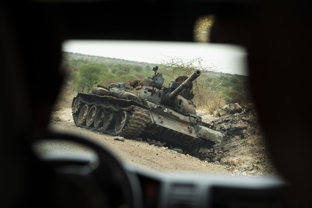 A destroyed tank is seen by the side of the road south of Humera, in an area of western Tigray annexed by the Amhara region during the ongoing conflic...