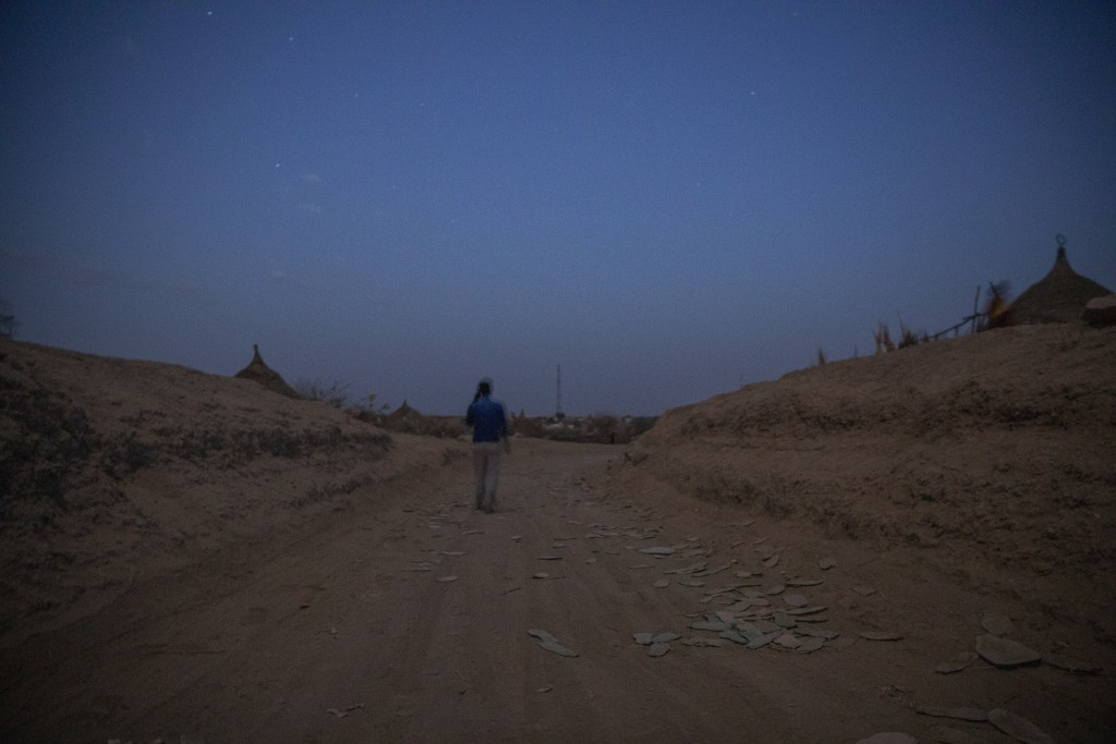 Surgeon and doctor-turned-refugee, Dr. Tewodros Tefera, makes his way to the clinic run by MSF (Doctors Without Borders), in Hamdayet, eastern Sudan, ...