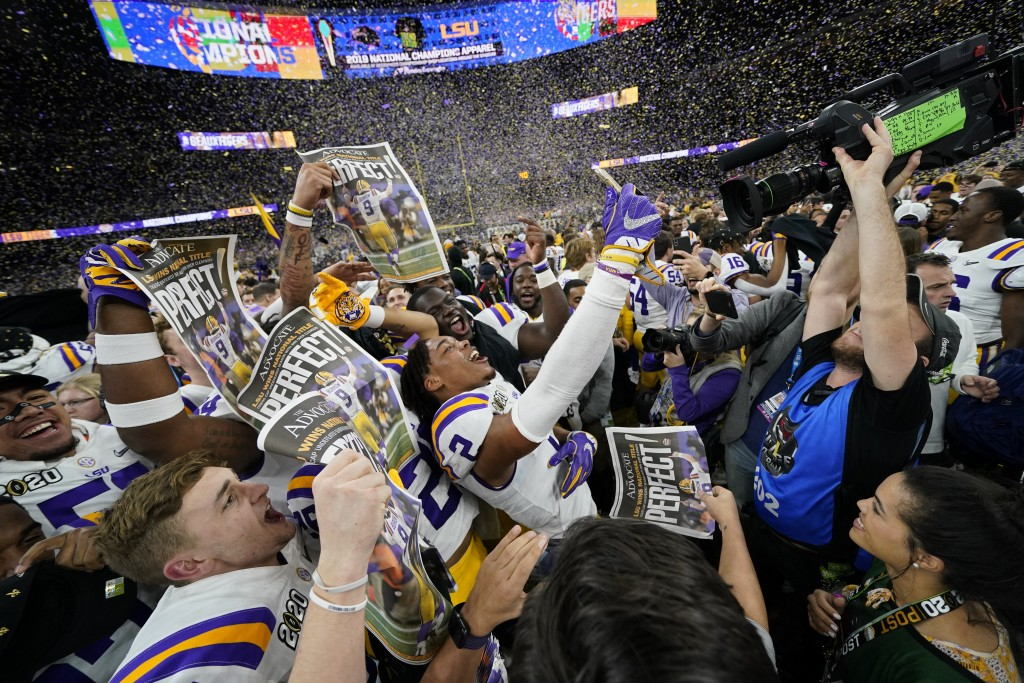 FILE - In this Jan. 13, 2020, file photo, LSU celebrates after their win against Clemson in a NCAA College Football Playoff national championship game...