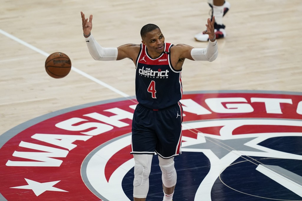 Washington Wizards guard Russell Westbrook reacts with the fans during a timeout during the second half of a basketball game against the Indiana Pacer...
