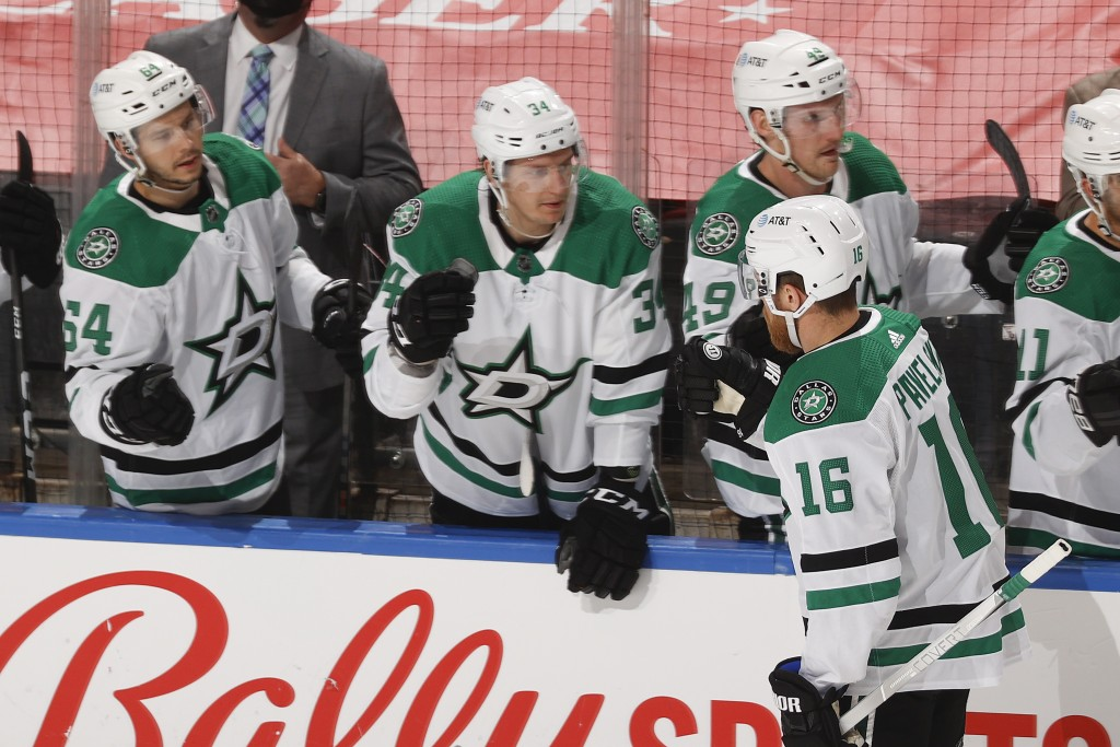 Teammates congratulate Dallas Stars center Joe Pavelski (16) after he scored a goal against the Florida Panthers during the first period of an NHL hoc...
