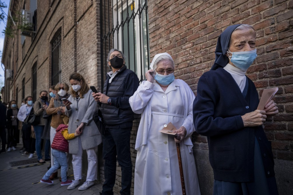 People queue to cast their votes during the regional election in Madrid, Spain, Tuesday, May 4, 2021. Over 5 million Madrid residents are voting for a...