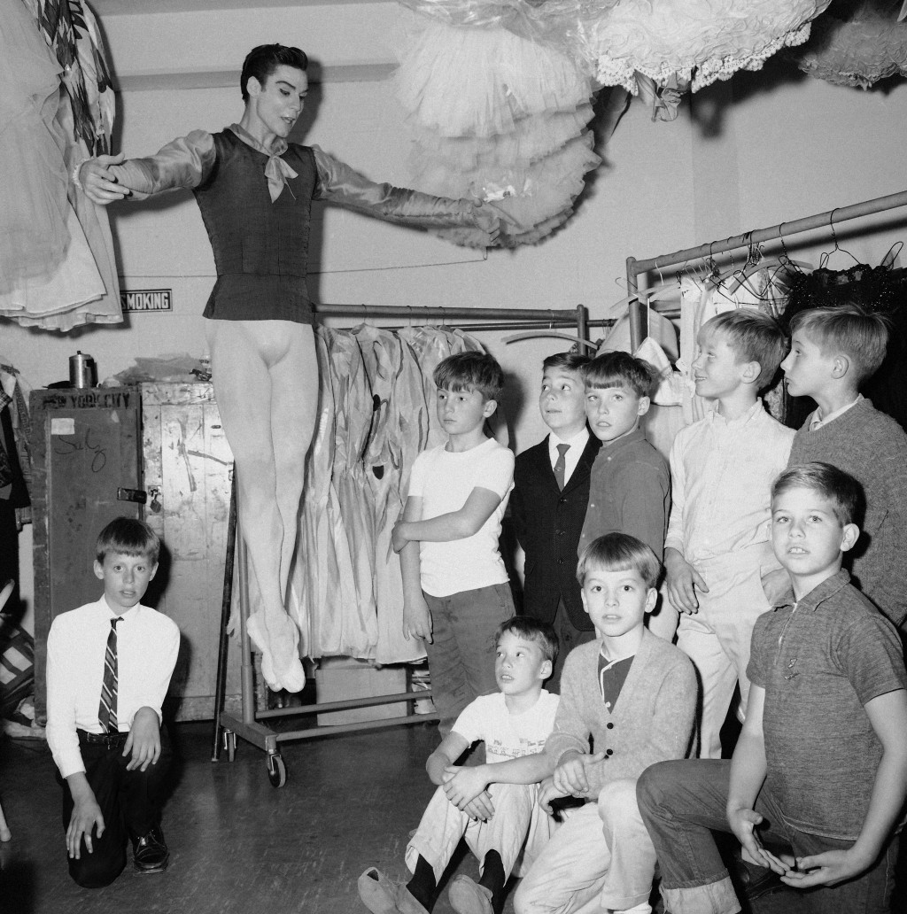 FILE - Jacques d'Amboise, principal dancer of the New York City ballet, demonstrates a jump to his young students backstage at New York's Lincoln Cent...