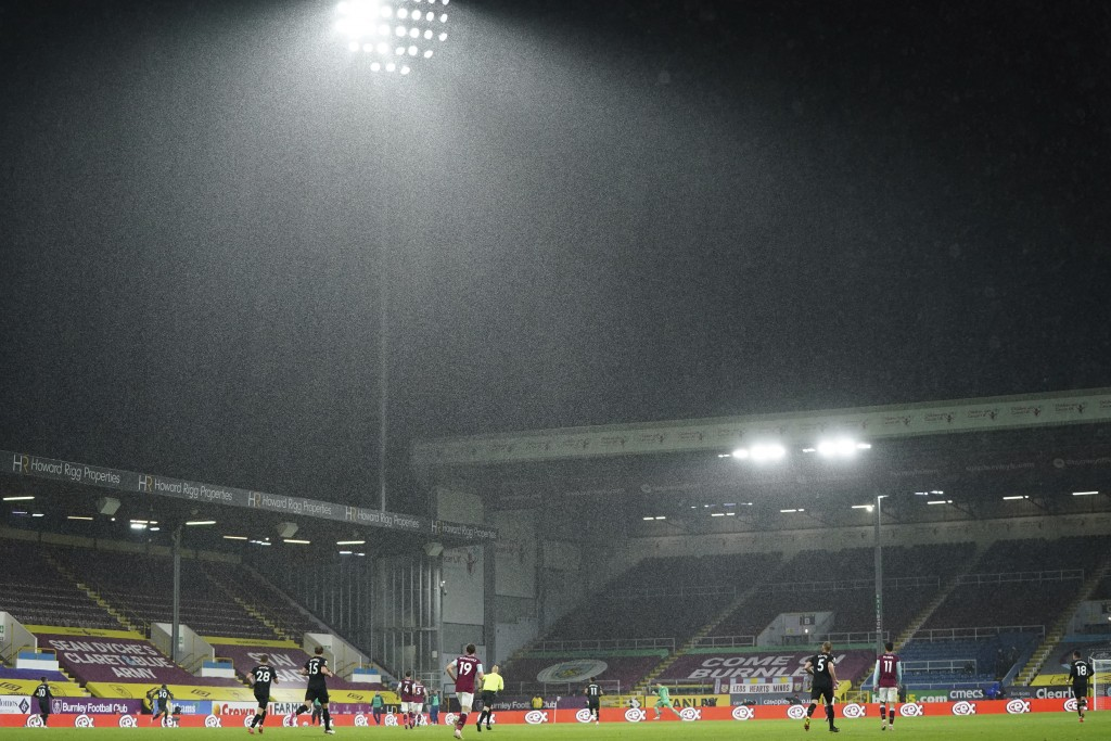 Heavy rain falls during the English Premier League soccer match between Burnley and West Ham United and at Turf Moor stadium in Burnley, England, Mond...