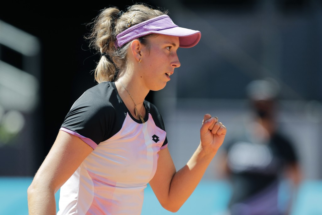 Elise Mertens of Belgium reacts after winning a point against Simona Halep of Romania during their match at the Madrid Open tennis tournament in Madri...