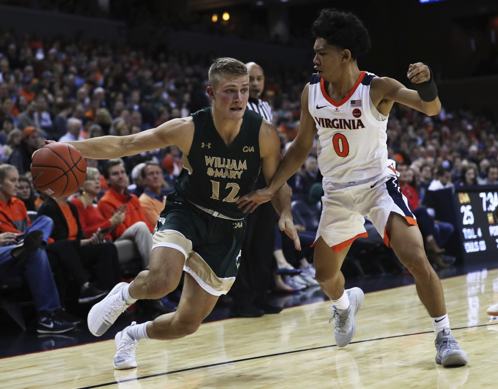 File-This Dec. 22, 2018, file photo shows William & Mary's guard Luke Loewe (12) driving around Virginia guard Kihei Clark (0) in the first half of an...