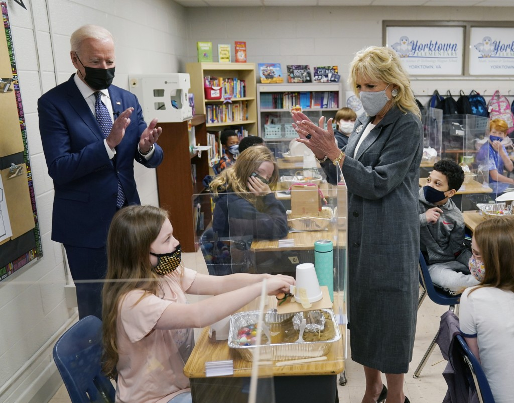President Joe Biden and first lady Jill Biden applaud a student as she demonstrates her project, during a visit to Yorktown Elementary School, Monday,...
