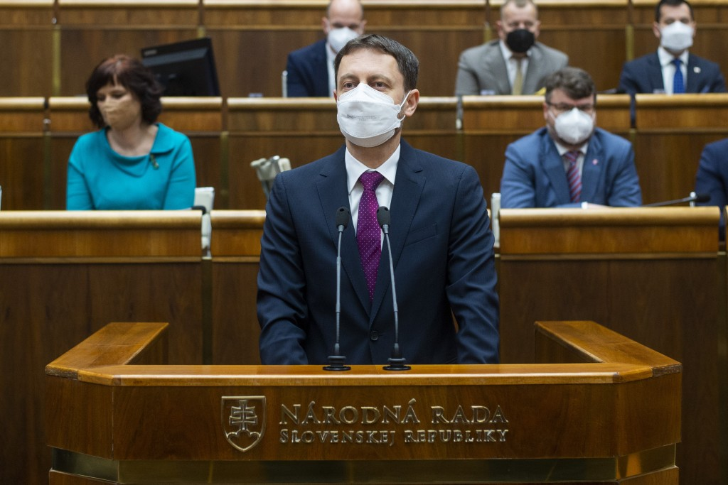 Slovakia Prime Minister Eduard Heger, addresses lawmakers in the parliament in Bratislava, Tuesday May 4, 2021.  Eduard Heger's Cabinet obtained a vot...