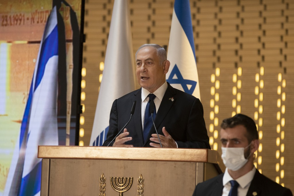 FILE - In this Wednesday, April 14, 2021 file photo, Israeli Prime Minister Benjamin Netanyahu speaks at a Memorial Day ceremony at the military cemet...
