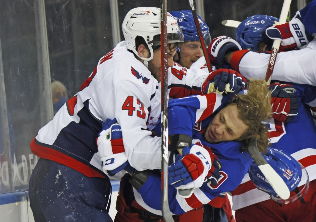 Washington Capitals' Tom Wilson (43) takes a roughing penalty during the second period against New York Rangers' Artemi Panarin (10) in an NHL hockey ...