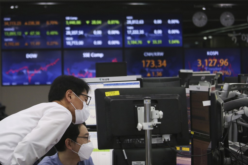 Currency traders watch monitors at the foreign exchange dealing room of the KEB Hana Bank headquarters in Seoul, South Korea, Tuesday, May 4, 2021. As...