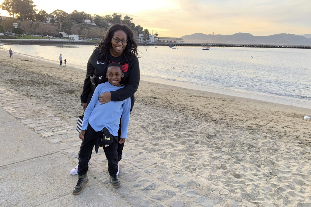 In this photo provided by Tanya Hayles, Hayles poses with her son Jackson, 7, in this undated photo. Hayles, founder of Black Moms Connection, an onli...