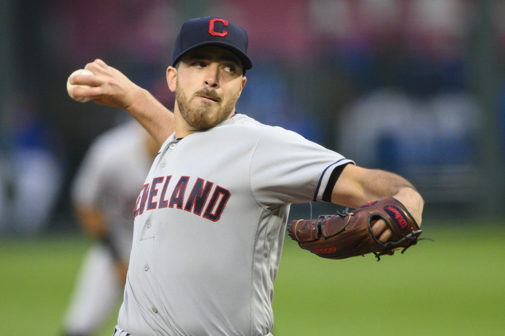 Cleveland Indians starting pitcher Aaron Civale throws during the first inning of a baseball game against the Kansas City Royals, Monday, May 3, 2021,...