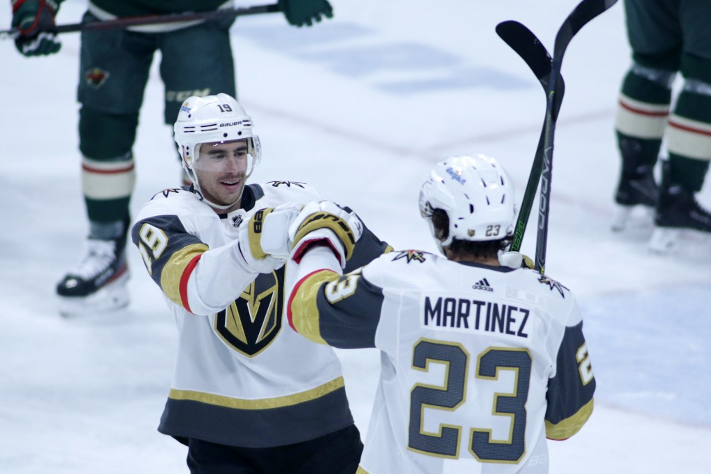 Vegas Golden Knights right wing Reilly Smith (19) and Vegas Golden Knights defenseman Alec Martinez (23) celebrate Martinez's goal against the Minneso...