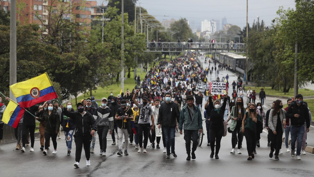 University students march during a national strike against tax reform in Bogota, Colombia, Monday, May 3, 2021. Colombia's President Ivan Duque withdr...