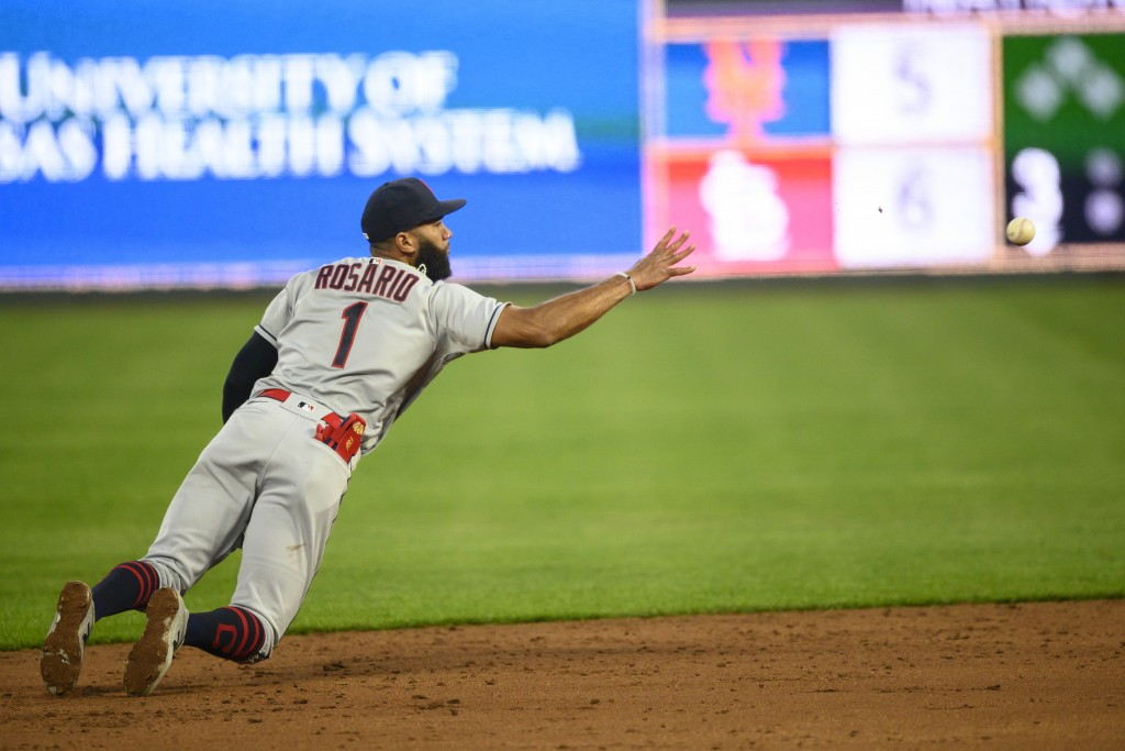 Cleveland Indians shortstop Amed Rosario tossed the ball to second for a force-out during the third inning of a baseball game Monday, May 3, 2021, in ...