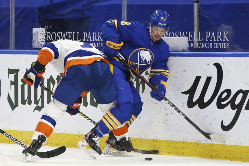 Buffalo Sabres defenseman Jacob Bryson (78) is checked by New York Islanders forward Jordan Eberle (7) during the second period of an NHL hockey game,...