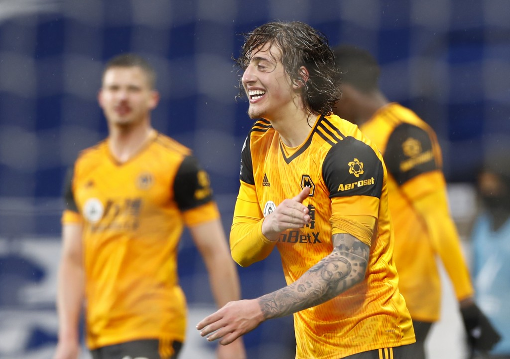 Wolverhampton Wanderers' Fabio Silva celebrates after scoring his side's opening goal during an English Premier League soccer match between West Bromw...