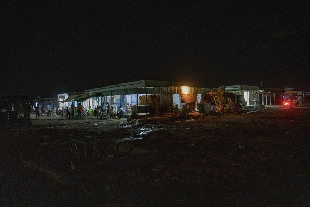 The main market in front of the clinic run by MSF (Doctors Without Borders), where surgeon and doctor-turned-refugee, Dr. Tewodros Tefera, goes to hel...