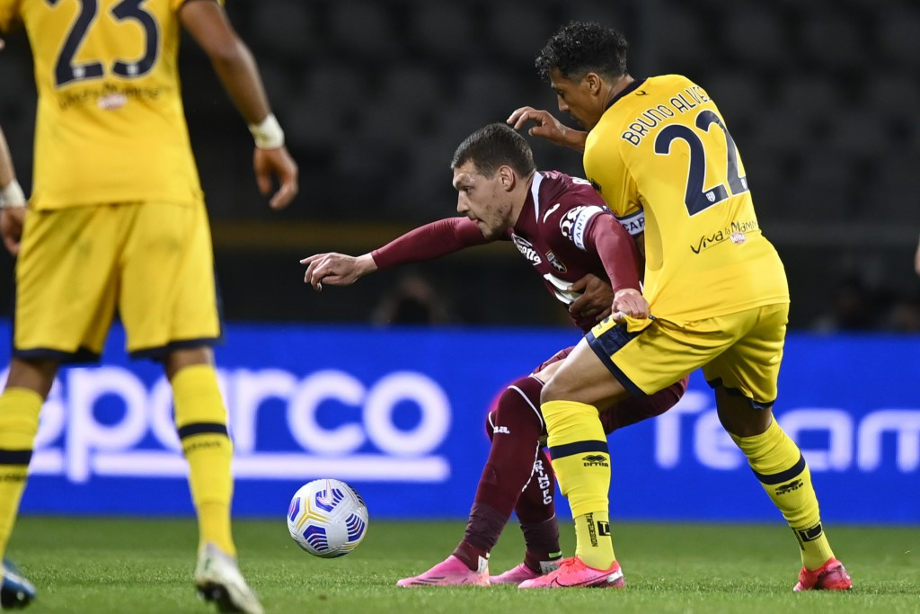 Torino's Andrea Belotti, center, in action during the Italian Serie A soccer match between Torino and Parma at the Olimpico Grande Torino stadium in T...