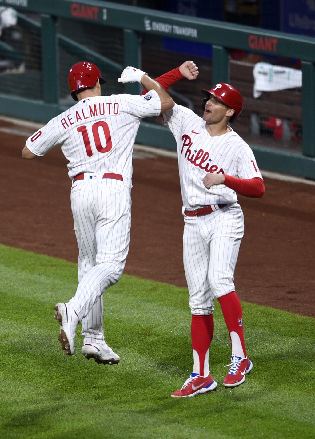 Philadelphia Phillies' J.T. Realmuto (10) is congratulated by Brad Miller after Realmuto hit a two-run home run off Milwaukee Brewers' Adrian Houser (...