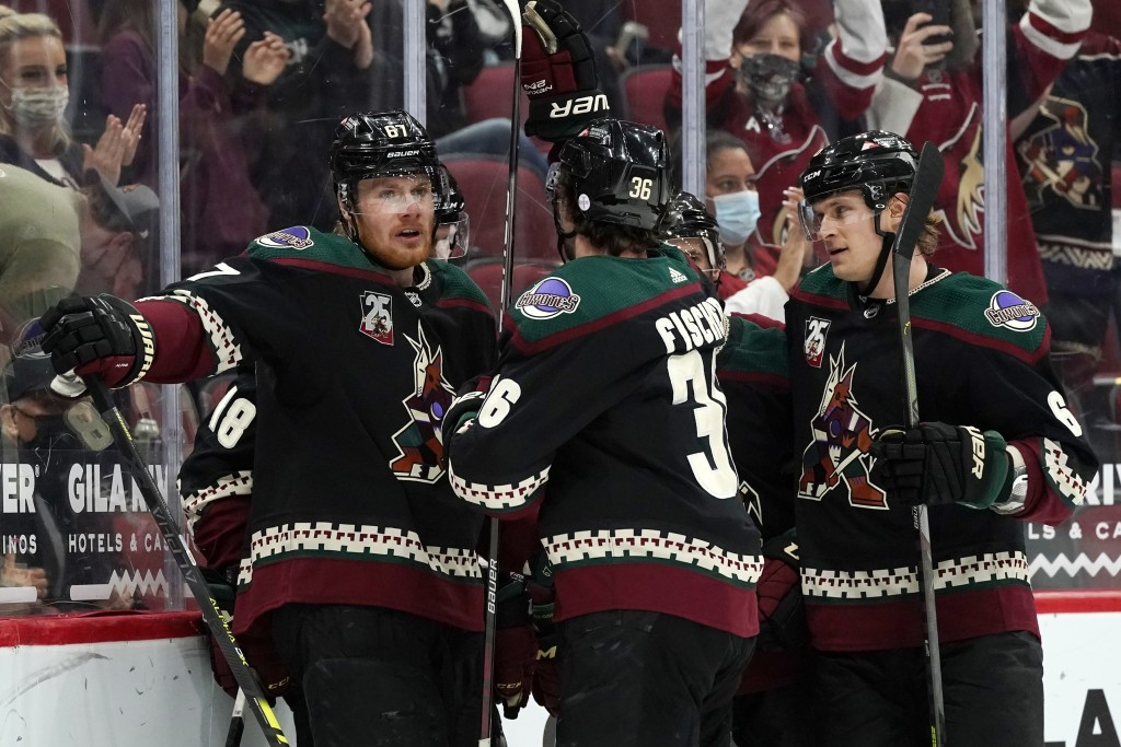 Arizona Coyotes left wing Lawson Crouse (67), Coyotes right wing Christian Fischer (36), and Coyotes defenseman Jakob Chychrun (6) celebrate a goal ag...