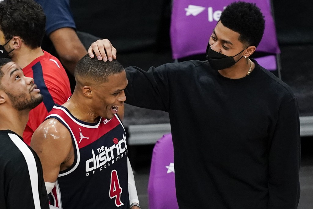Washington Wizards guard Russell Westbrook (4) talks with Indiana Pacers' Jeremy Lamb, right, after a basketball game, Monday, May 3, 2021, in Washing...