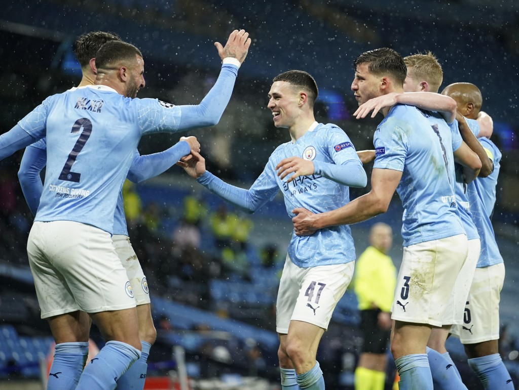 Manchester City's Riyad Mahrez celebrates with teammates after scoring his sides second goal during the Champions League semifinal second leg soccer m...