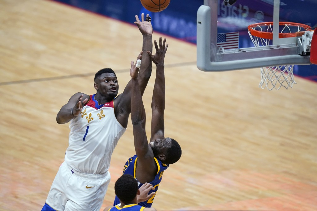 New Orleans Pelicans forward Zion Williamson (1) shoots against Golden State Warriors forward Draymond Green in the second half of an NBA basketball g...
