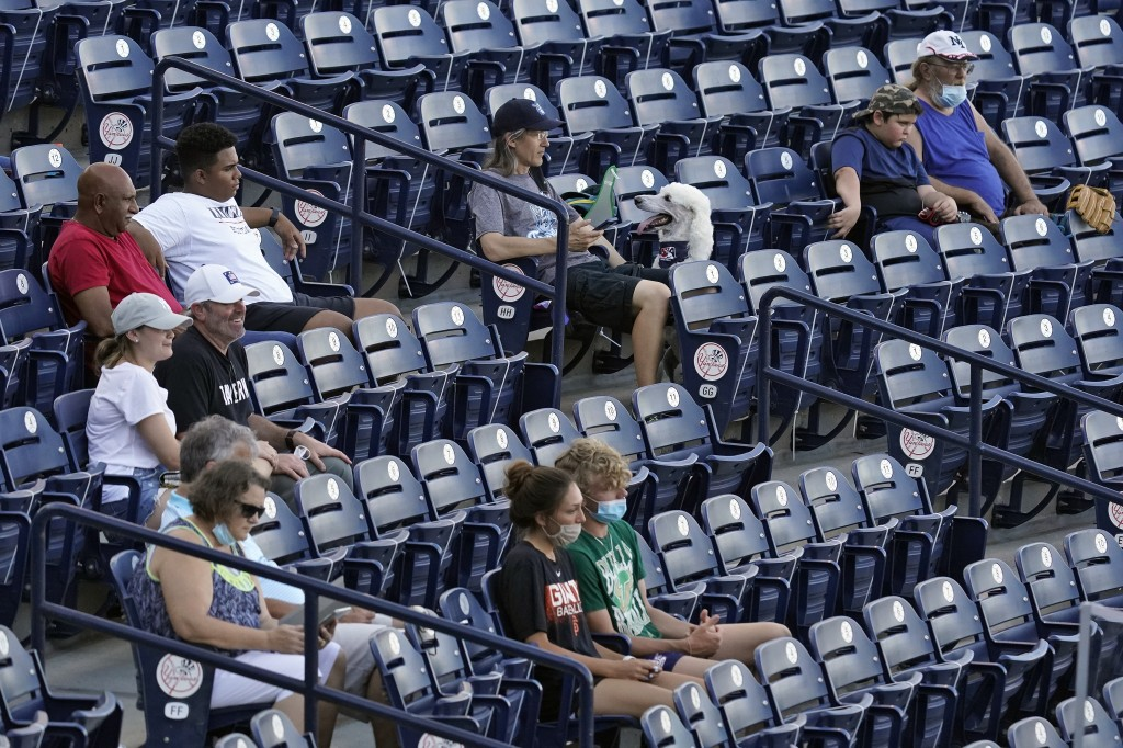 Fans are socially distanced during the first inning of a Low A Southeast League baseball game between the Dunedin Blue Jays and the Tampa Tarpons at G...