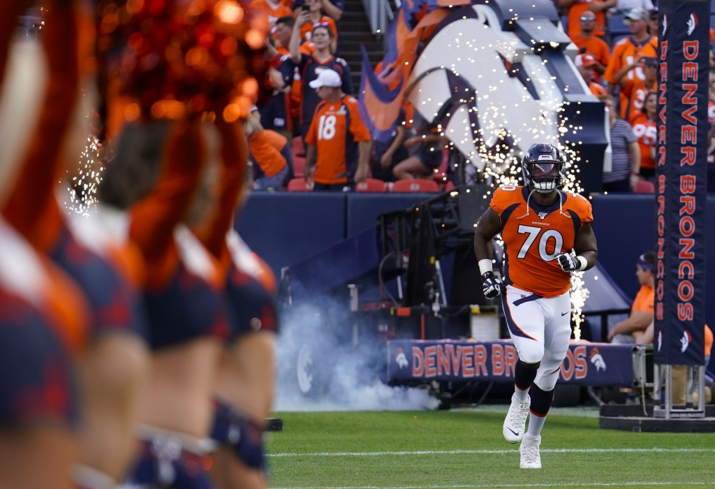 File-This Aug. 19, 2019, file photo shows Denver Broncos offensive tackle Ja'Wuan James (70) taking the field during an NFL preseason football game be...