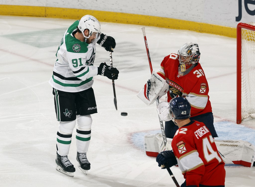 File-This May 3, 2021, file photo shows Dallas Stars center Tyler Seguin (91) scoring a game-tying goal past Florida Panthers goaltender Spencer Knigh...