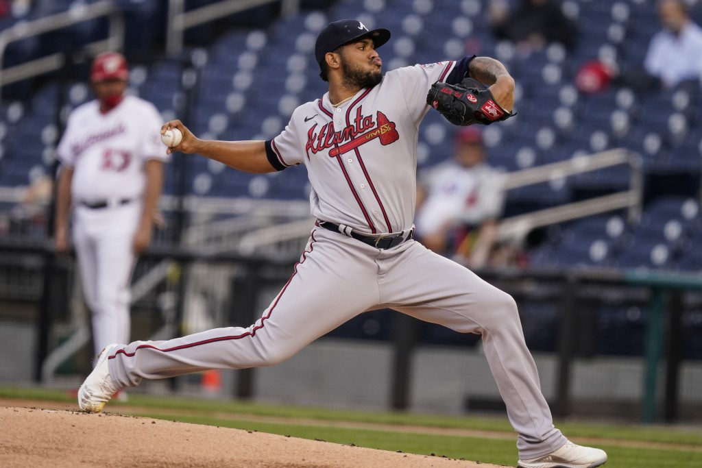 Atlanta Braves starting pitcher Huascar Ynoa throws during the first inning of baseball game against the Washington Nationals at Nationals Park, Tuesd...