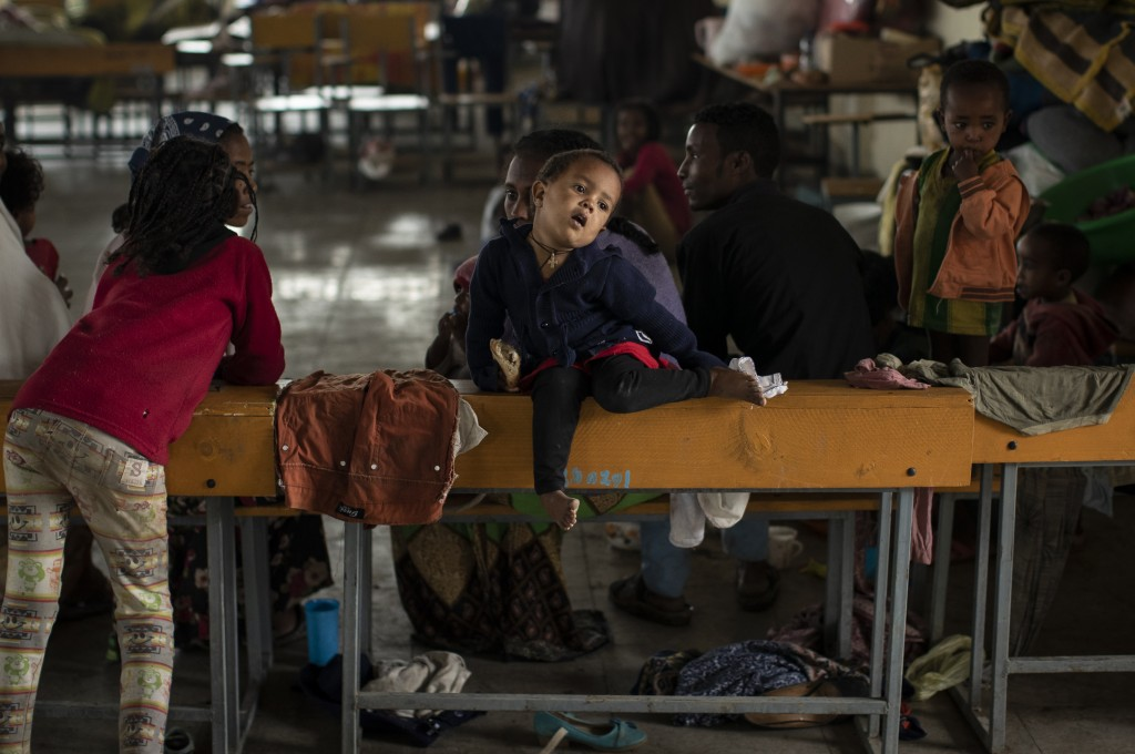 A displaced Tigrayan child sits on a school desk in a classroom where they now live at the Hadnet General Secondary School which has become a makeshif...