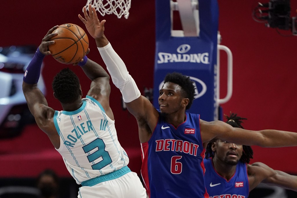 Charlotte Hornets guard Terry Rozier (3) shoots over the defense of Detroit Pistons guard Hamidou Diallo (6) during the second half of an NBA basketba...