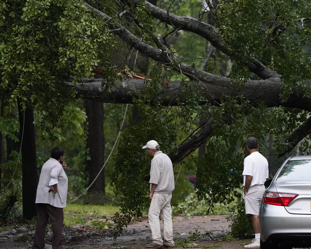 Neighbors inspect the wind toppled trees in this northeast Jackson, Miss., neighborhood, Tuesday, May 4, 2021. The severe weather was not unexpected, ...