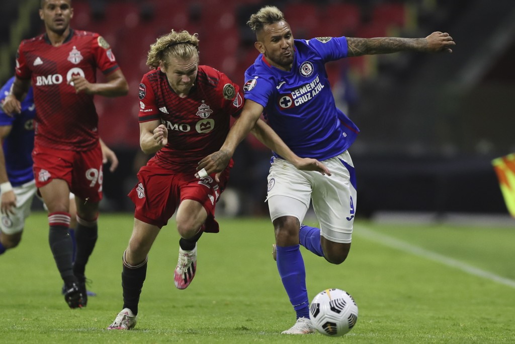 Walter Montoya of Mexico's Cruz Azul, right, and Jacob Shaffelburg of Canada's Toronto FC fight for the ball during CONCACAF Champions League quarterf...