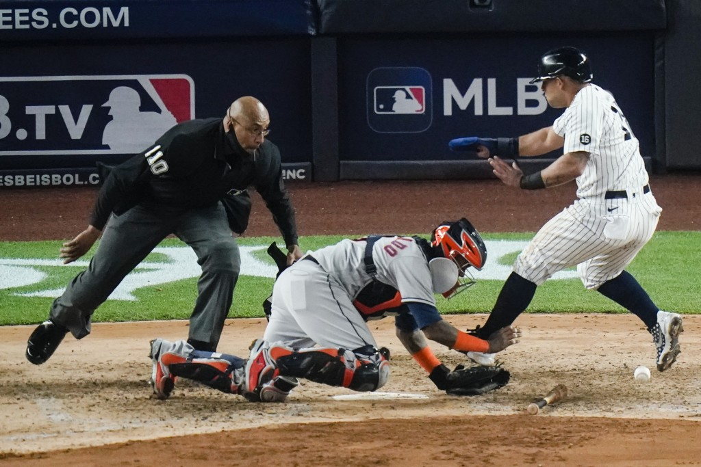 New York Yankees' Rougned Odor runs past Houston Astros catcher Martin Maldonado to score during the sixth inning of a baseball game Tuesday, May 4, 2...