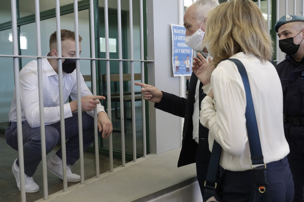 Finnegan Lee Elder, left, talks with his parents Ethan and Leah Elder, before a jury began deliberating the fates of Elder and his co-defendant Gabrie...