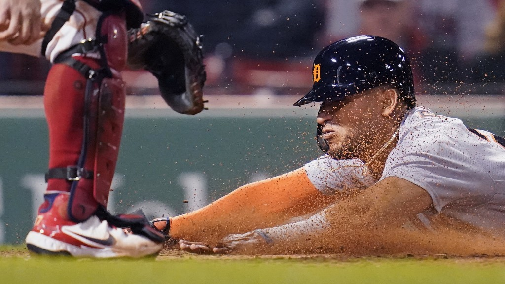 Detroit Tigers' Reyes slides head first into home while scoring on an RBI double by Robbie Grossman during the fifth inning of a baseball game against...