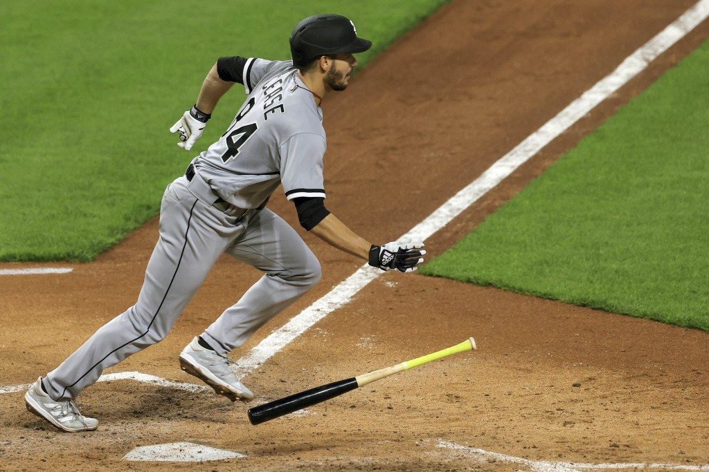 Chicago White Sox Dylan Cease hits for a single during the fifth inning of a baseball game against the Cincinnati Reds, Tuesday, May 4, 2021 in Cincin...
