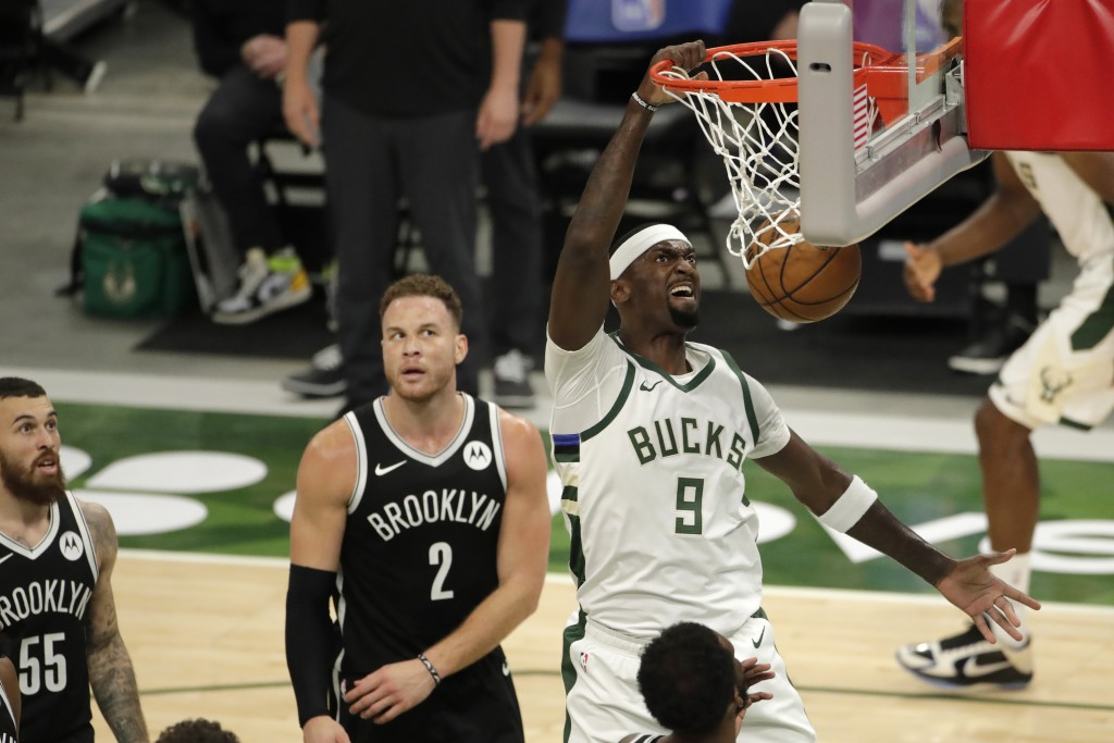 Milwaukee Bucks' Bobby Portis dunks during the first half of an NBA basketball game against the Brooklyn Nets Tuesday, May 4, 2021, in Milwaukee. (AP ...