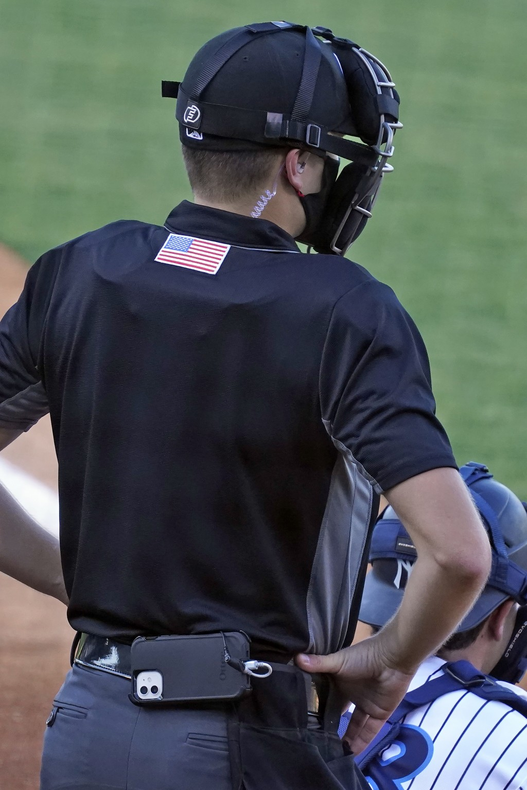 Home plate umpire Kaleb Devier wears an earpiece and a battery pack during a Low A Southeast League baseball game between the Dunedin Blue Jays and th...