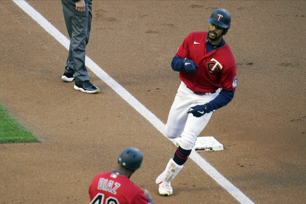 Minnesota Twins Byron Buxton rounds third base on a two-run home run off Texas Rangers' pitcher Kyle Gibson in the first inning of a baseball game, Tu...