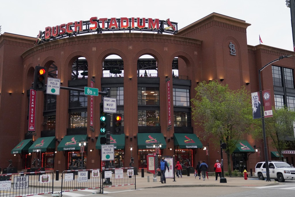 People walk outside Busch Stadium after the scheduled start of a baseball game between the St. Louis Cardinals and the New York Mets Tuesday, May 4, 2...