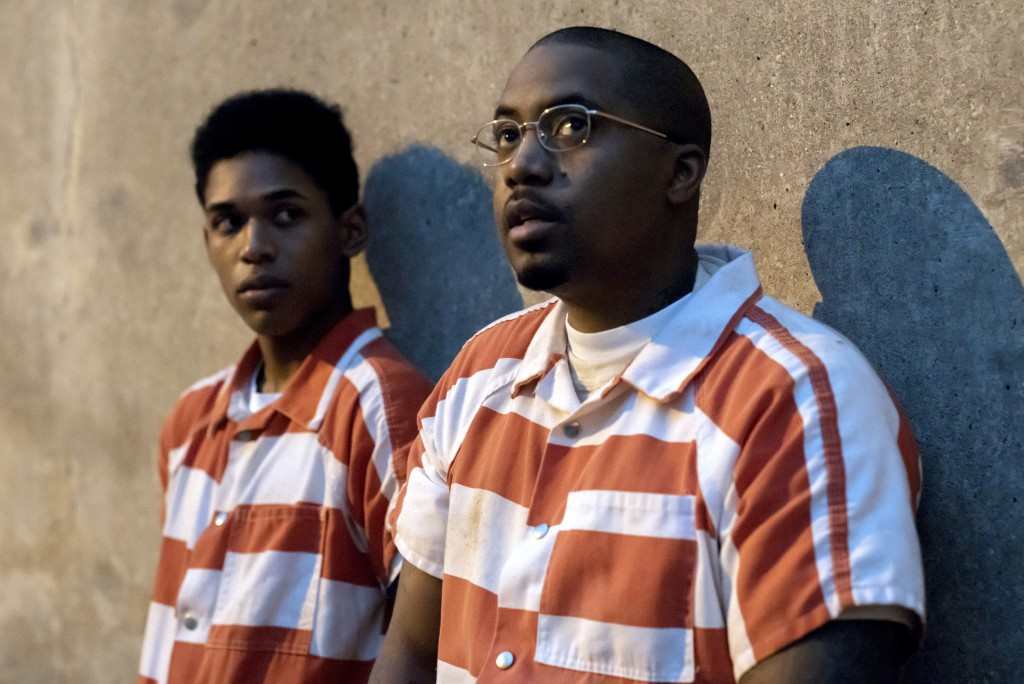 """This image released by Netflix shows Kevin Harrison Jr., left, and Nasir """"Nas"""" Jones in a scene from """"Monster."""" (Netflix via AP)"""