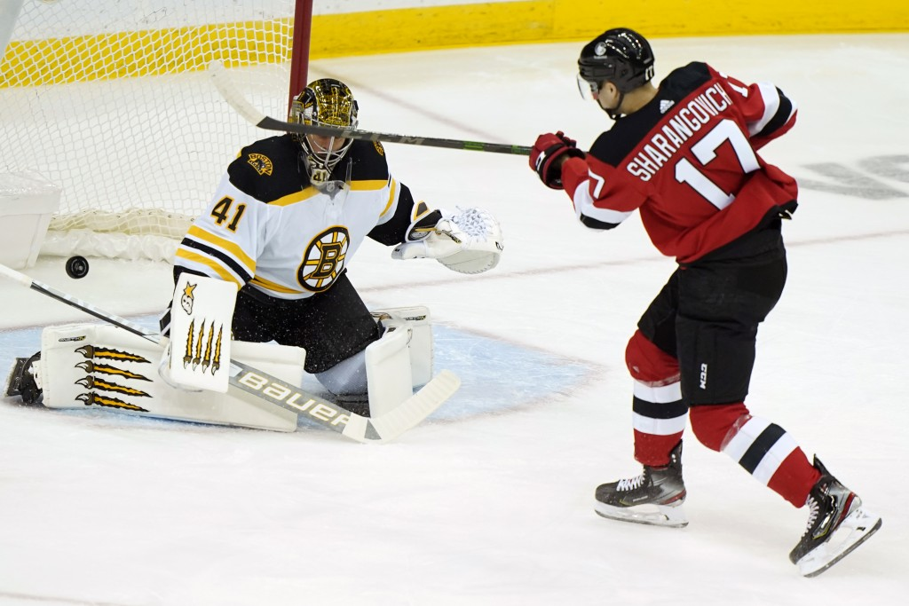Boston Bruins goaltender Jaroslav Halak (41) makes a save on a shot by New Jersey Devils center Yegor Sharangovich (17) during the first period of an ...